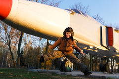 Portrait of happy young boy. Jumping near by airplane Stock Photo