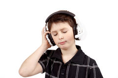 Portrait of a happy young boy listening to music on headphones Royalty Free Stock Images