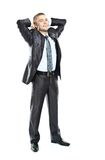 Happy young business man relaxing with hands behind head Royalty Free Stock Photography