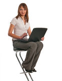 Portrait of a happy young business woman. With a laptop stock images