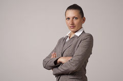 Portrait of a happy young business woman. Fold one's arms Royalty Free Stock Photography