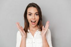 Portrait of a happy young business woman. Celebrating success  over white background Stock Image