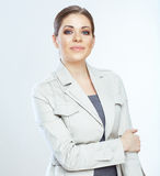 Portrait of happy young business woman crossed arm Stock Image