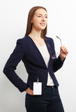 Portrait of happy young business woman with glasses over white b Royalty Free Stock Photo
