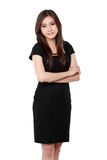 Portrait of a happy young business woman standing with folded ha Royalty Free Stock Photo