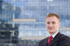Portrait of a happy young businessman. Outdoor the office Royalty Free Stock Photos