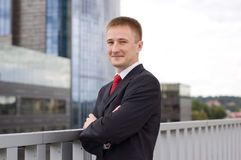 Portrait of a happy young businessman. Outdoor the office Royalty Free Stock Image