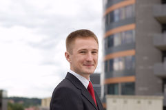 Portrait of a happy young businessman. Outdoor the office Royalty Free Stock Photography