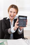 Businesswoman Showing Calculator Royalty Free Stock Photos
