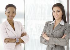 Portrait of happy young businesswomen in office stock photos