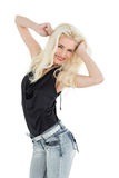Portrait of a happy young casual woman dancing Royalty Free Stock Photos