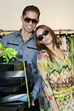 Portrait of a happy young couple with boxes in fashion store Stock Photo