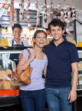Portrait Of Happy Young Couple At Cheese Shop royalty free stock photos