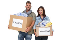 Portrait of a happy young couple with clothes donation Stock Image