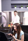 Portrait of happy young couple cooking together in the kitchen. Royalty Free Stock Photo