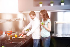 Portrait of happy young couple cooking together in the kitchen Royalty Free Stock Photo