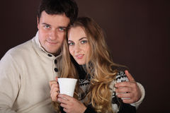 Portrait of a happy young couple with cup Stock Photography