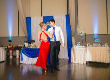 Portrait Of Happy Young Couple Dancing Tango at wedding banquet Royalty Free Stock Photo