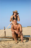Portrait of a happy young couple enjoying on beach Royalty Free Stock Photography