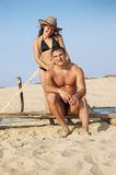 Portrait of a happy young couple enjoying on beach Stock Photos