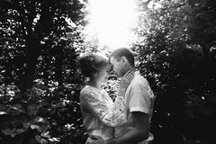 Portrait of a happy young couple enjoying a day in the park together. Black and white royalty free stock image