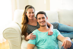Portrait of happy young couple enjoying together in living room Stock Images