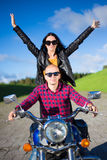 Portrait of happy young couple going to travel on motorbike Royalty Free Stock Photography
