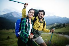 Portrait of happy young couple having fun on their hiking trip stock photo