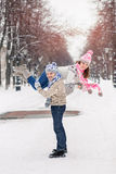 Portrait of happy young couple having fun in winter park Stock Images