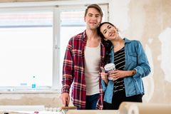 Portrait of a happy young couple holding tools for home remodeli Stock Image
