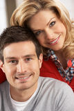 Portrait Of Happy Young Couple At Home Royalty Free Stock Images