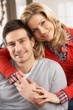 Portrait Of Happy Young Couple At Home Stock Photos