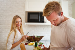 Portrait of happy young couple at the kitchen Stock Photos