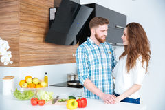 Portrait of happy young couple on the kitchen Royalty Free Stock Photos