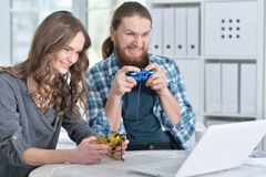 Young couple with laptop. Portrait of happy young couple with laptop playing game at home Stock Image