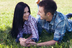 Portrait of happy young couple looking at each other. stock images