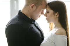 Portrait of happy young couple looking at each other and smiling. relationship between people. Portrait of happy young couple looking at each other and smiling royalty free stock image