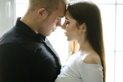 Portrait of happy young couple looking at each other and smiling. relationship between people. Portrait of happy young couple looking at each other and smiling stock photos