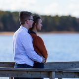 Portrait of happy young couple in love on blurred background of Royalty Free Stock Photos