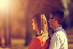 Portrait of happy young couple in love on blurred nature backgro Royalty Free Stock Images