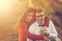 Portrait of happy young couple in love on blurred nature backgro Stock Image