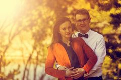 Portrait of happy young couple in love on blurred nature backgro Stock Photography