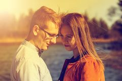 Portrait of happy young couple in love on blurred nature backgro Stock Photos