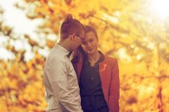 Portrait of happy young couple in love on blurred nature backgro Stock Images