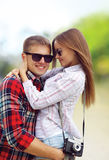 Portrait happy young couple in love summer, wearing sunglasses, having fun Stock Photos