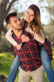 Portrait of a happy young couple in the nature hugged together Royalty Free Stock Photo