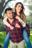 Portrait of a happy young couple in the nature hugged together Royalty Free Stock Photos
