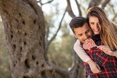 Portrait of a happy young couple in the nature hugged together Stock Photography