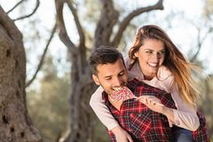 Portrait of a happy young couple in the nature hugged together Royalty Free Stock Images