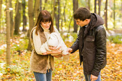 Portrait of a happy young couple playing with their cute newborn baby Royalty Free Stock Image